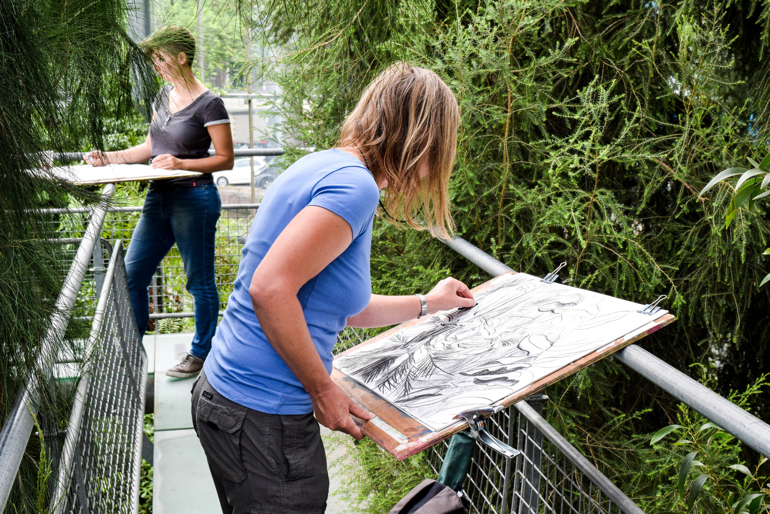 Two artists drawing sketches in the Hortus Botanicus Amsterdam