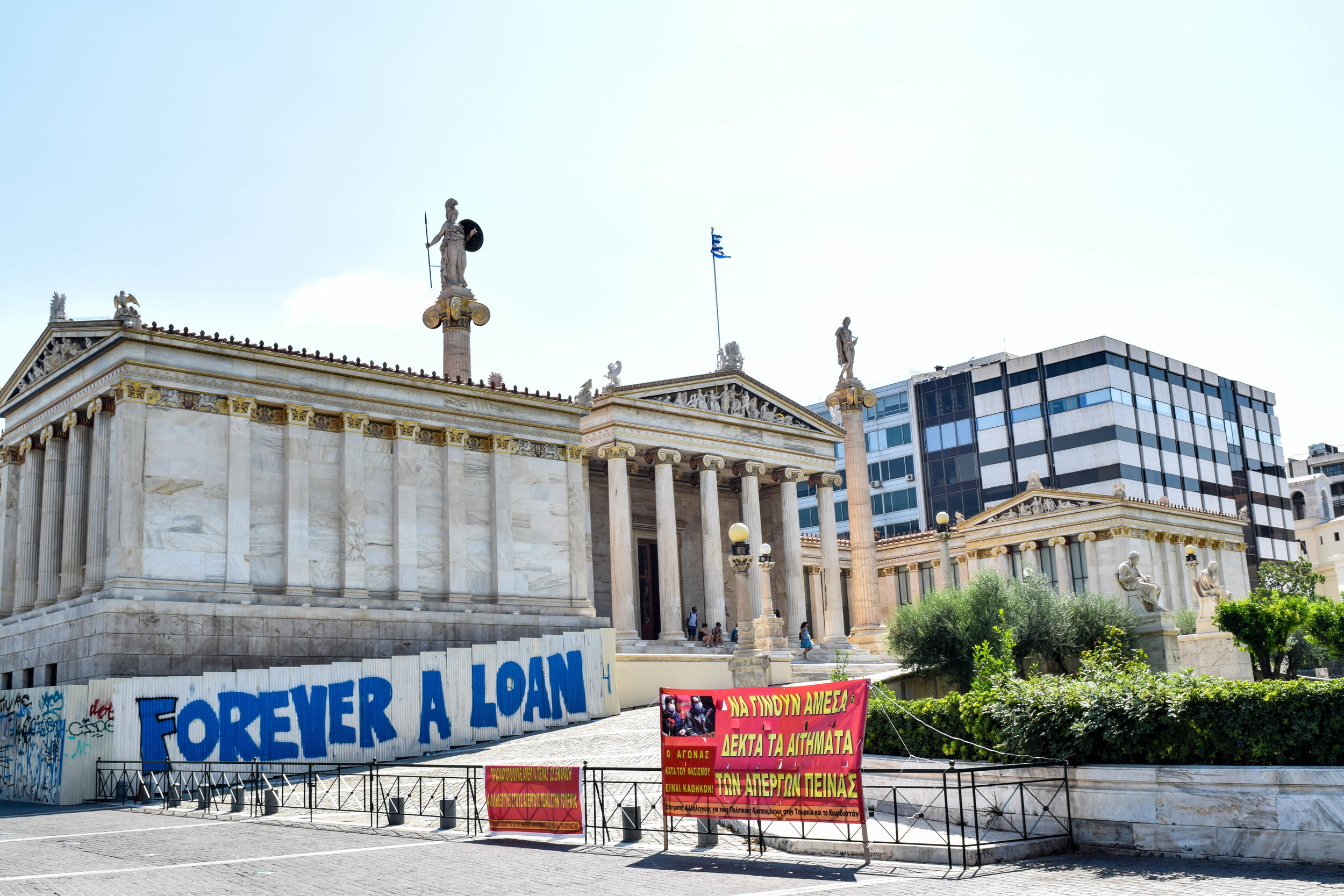 Athens in a nutshell: old buildings + financial crisis.