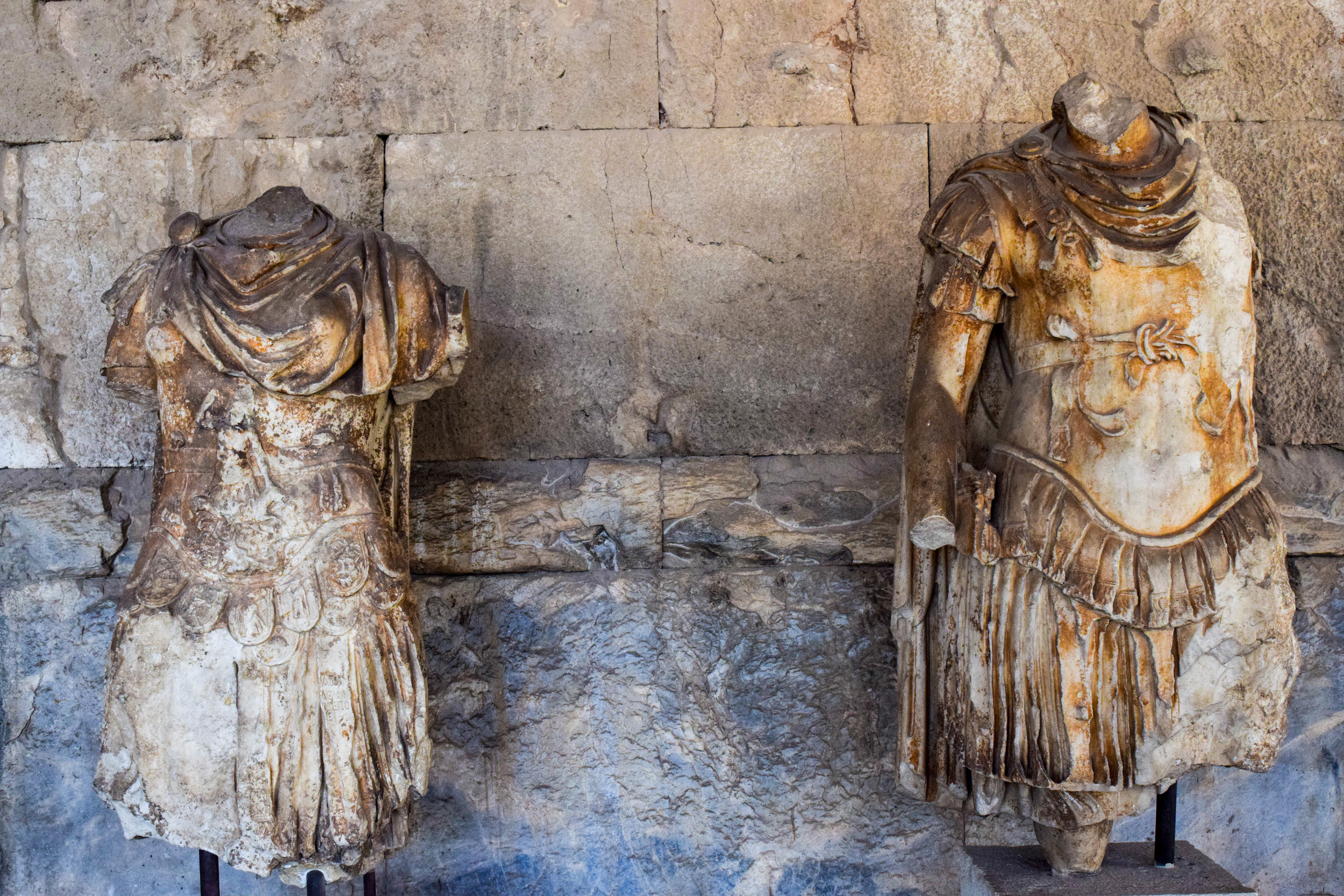 Ancient, weathered statues on display in the Agora museum.