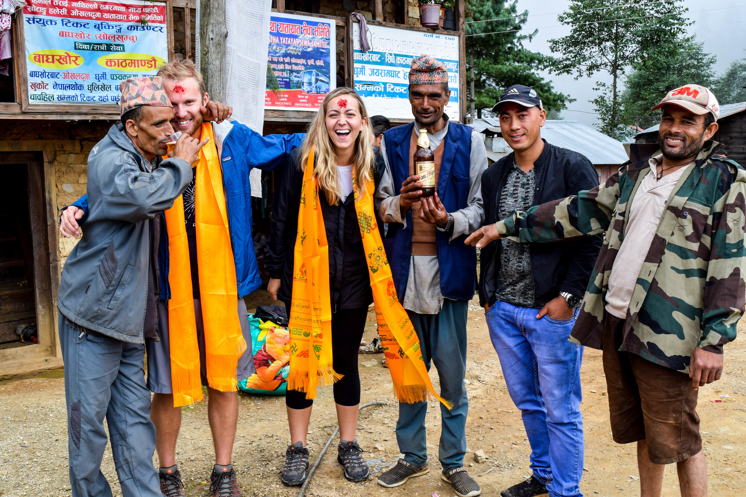 Us, our guide's brothers, and San Miguel, Nepal's favorite beer.
