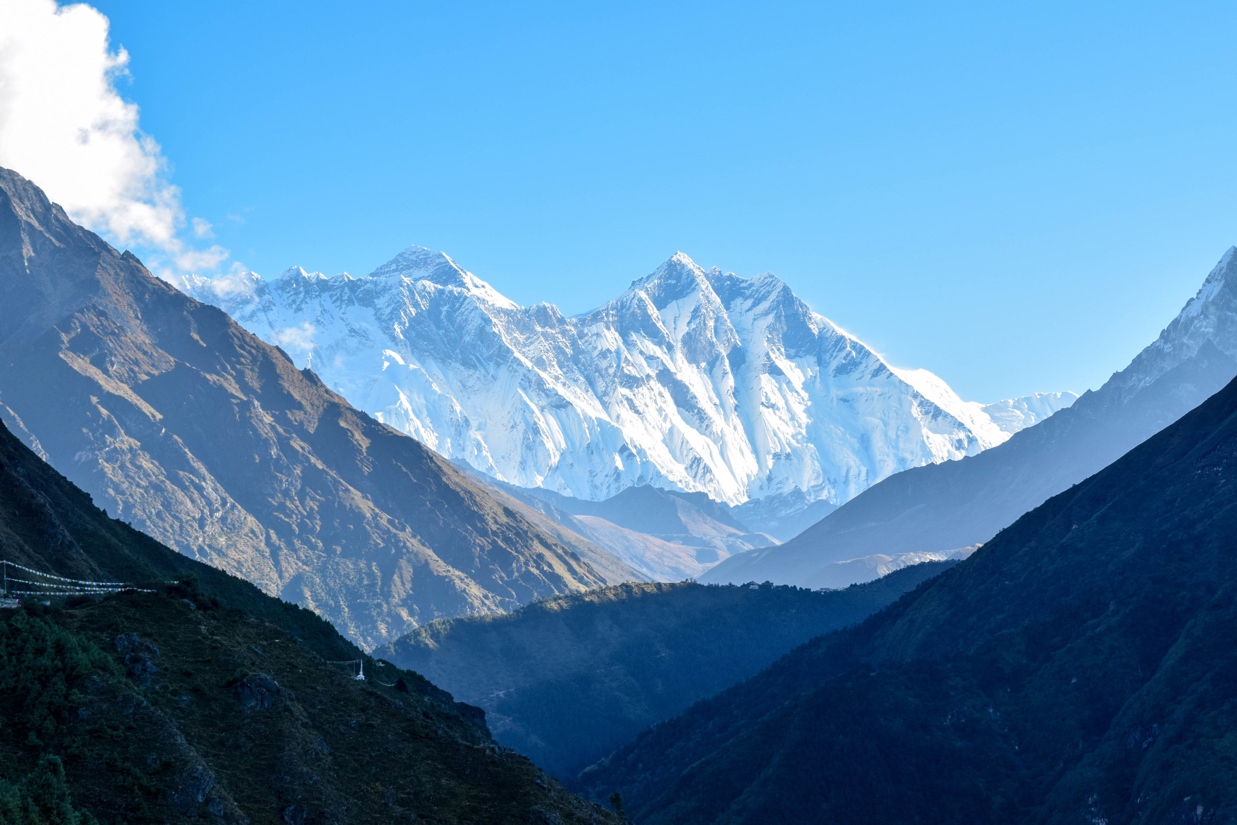 Thar she blows: Everest is the broad, flat peak in the center, with Lhotse on the right and Nuptse is the ridge on the left. Lhotse looks taller from here,but don't believe her lies.