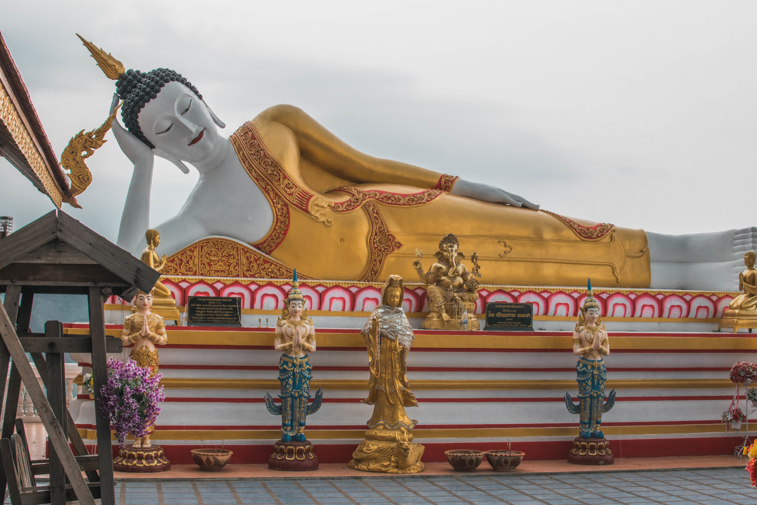 The Reclining Buddha is one of the most famous components of the lovely Wat Phra That Doi Kham.
