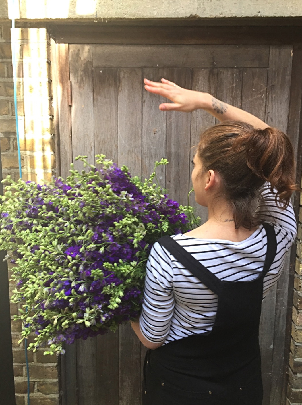 Arm full of Larkspur, prepping for a wedding at our Peckham Studio