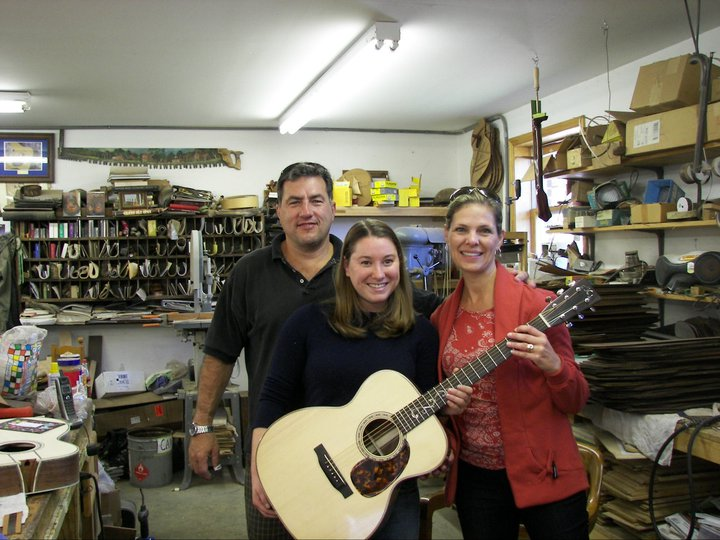 Pam and Ted VanDyk with EJ Henderson #1. Local wood, Walnut OM, all proceeds donated to the French Broad Riverkeeper program.
