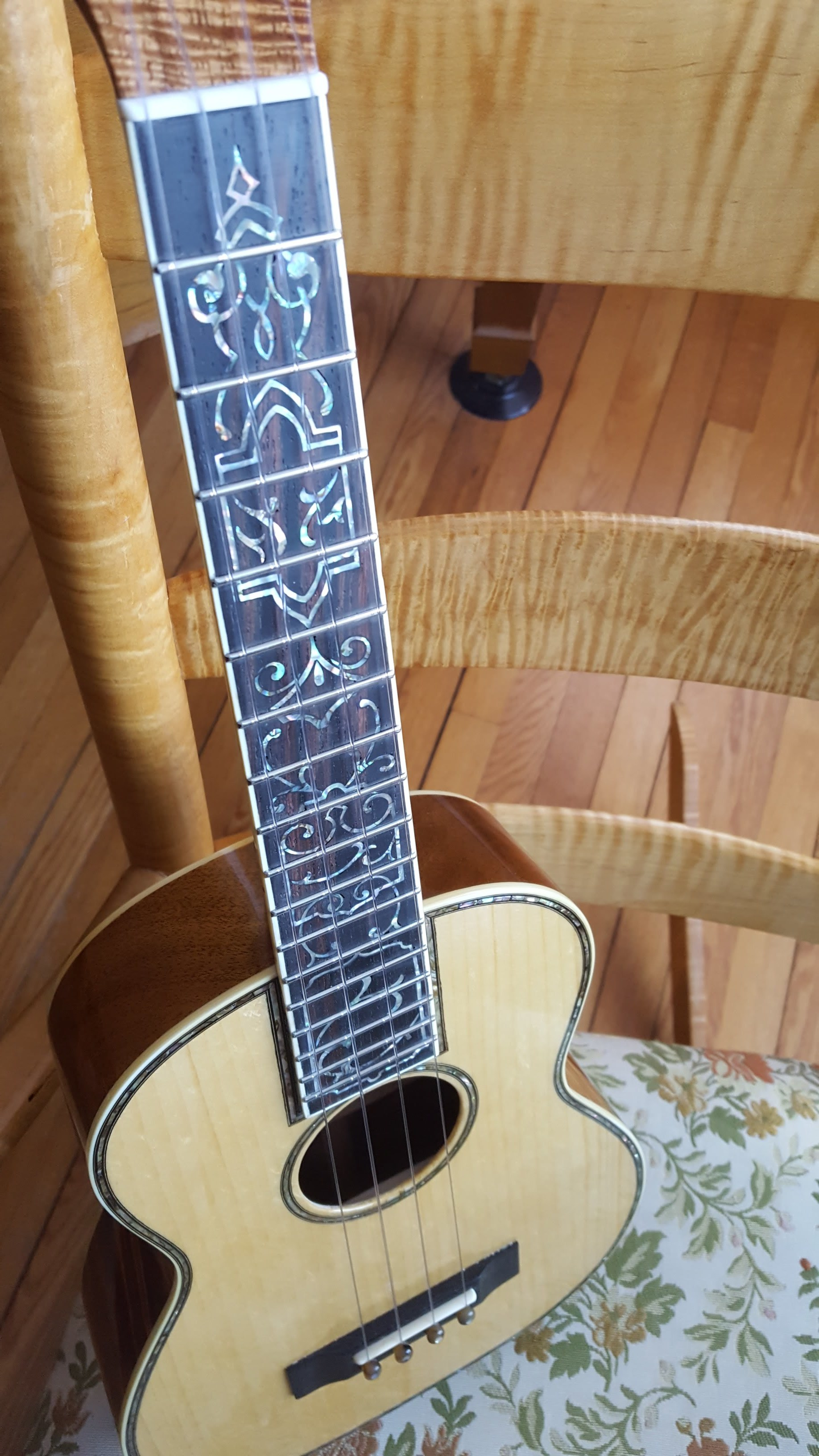 Hand drawn art deco fingerboard design on a koa tenor ukulele.