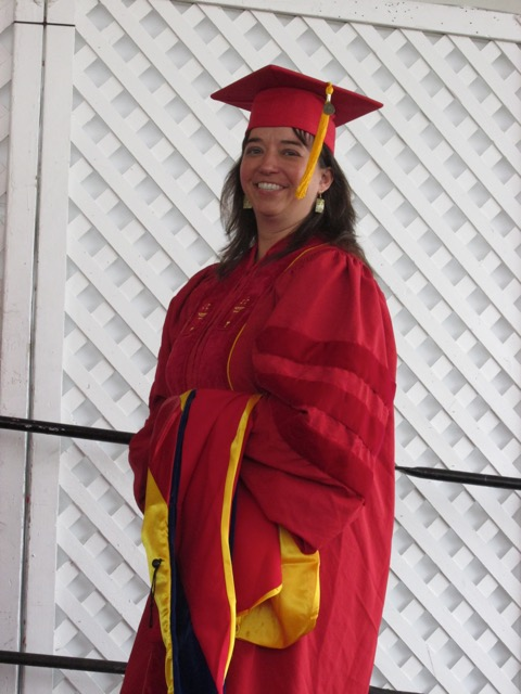 Michelle Damian, now a professor at Monmouth College, walks to accept her diploma.