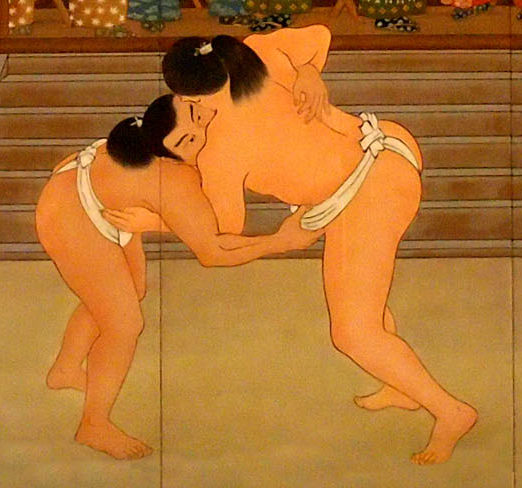 Sumo wrestlers in a match depicted on a mural at the Ryōgoku Kokugikan.