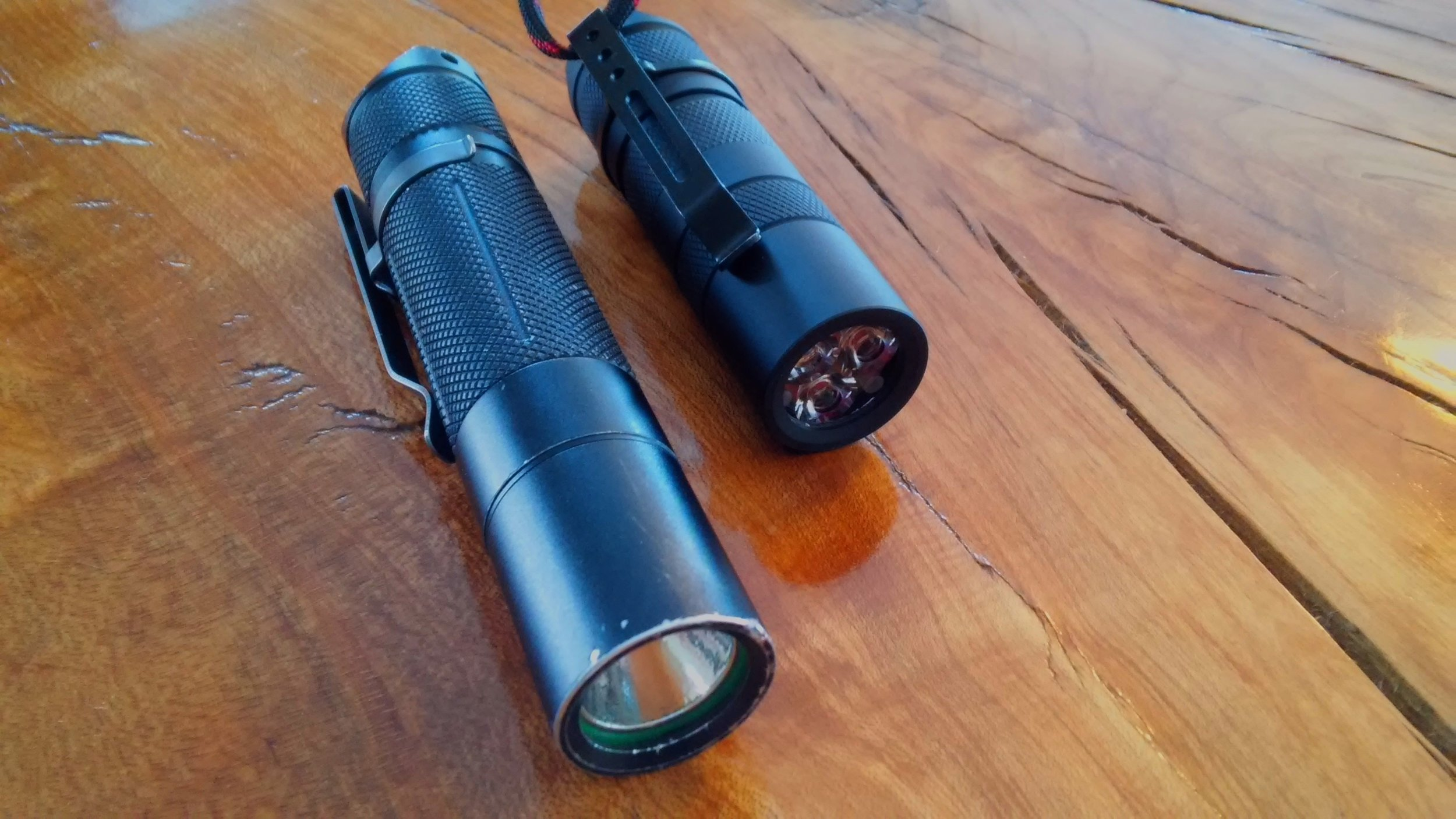 Convoy S2 w/ 18350 battery tube, but holding an 18500, Astrolux S1/BLF A6 at left for size.