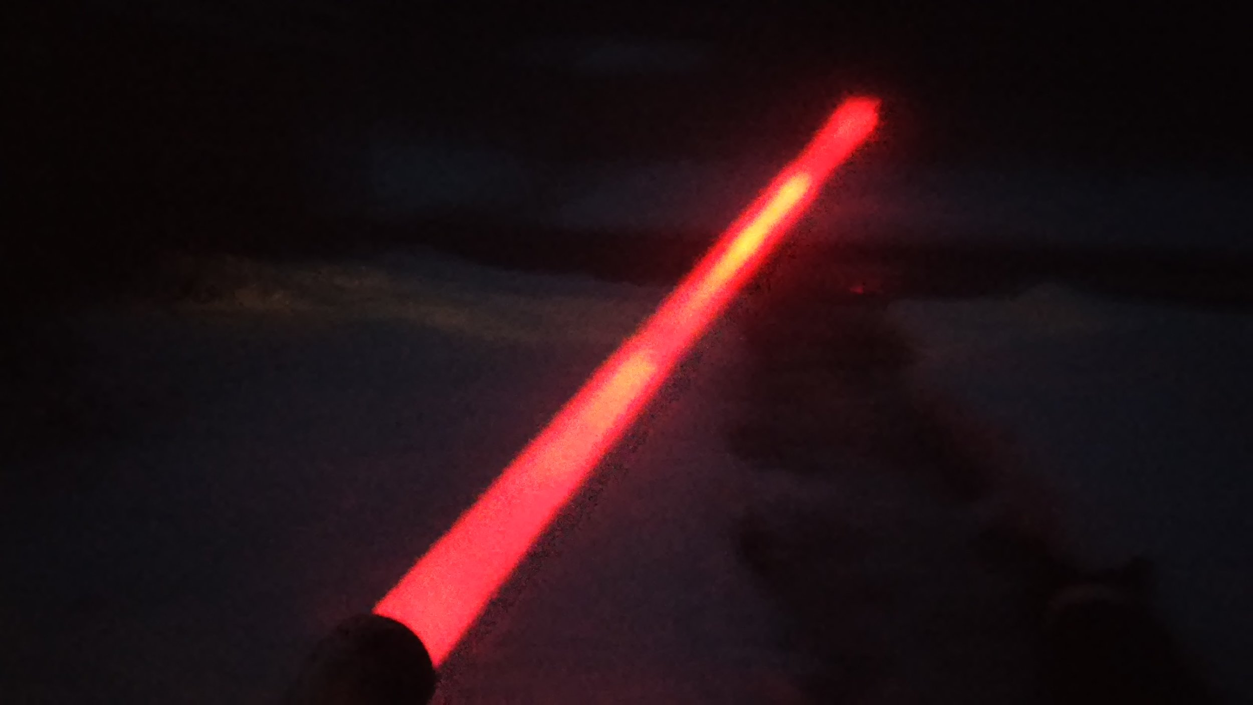 Potato quality phone pic of the red Strike in the fog on our last night with it prior to delivery to the customer.