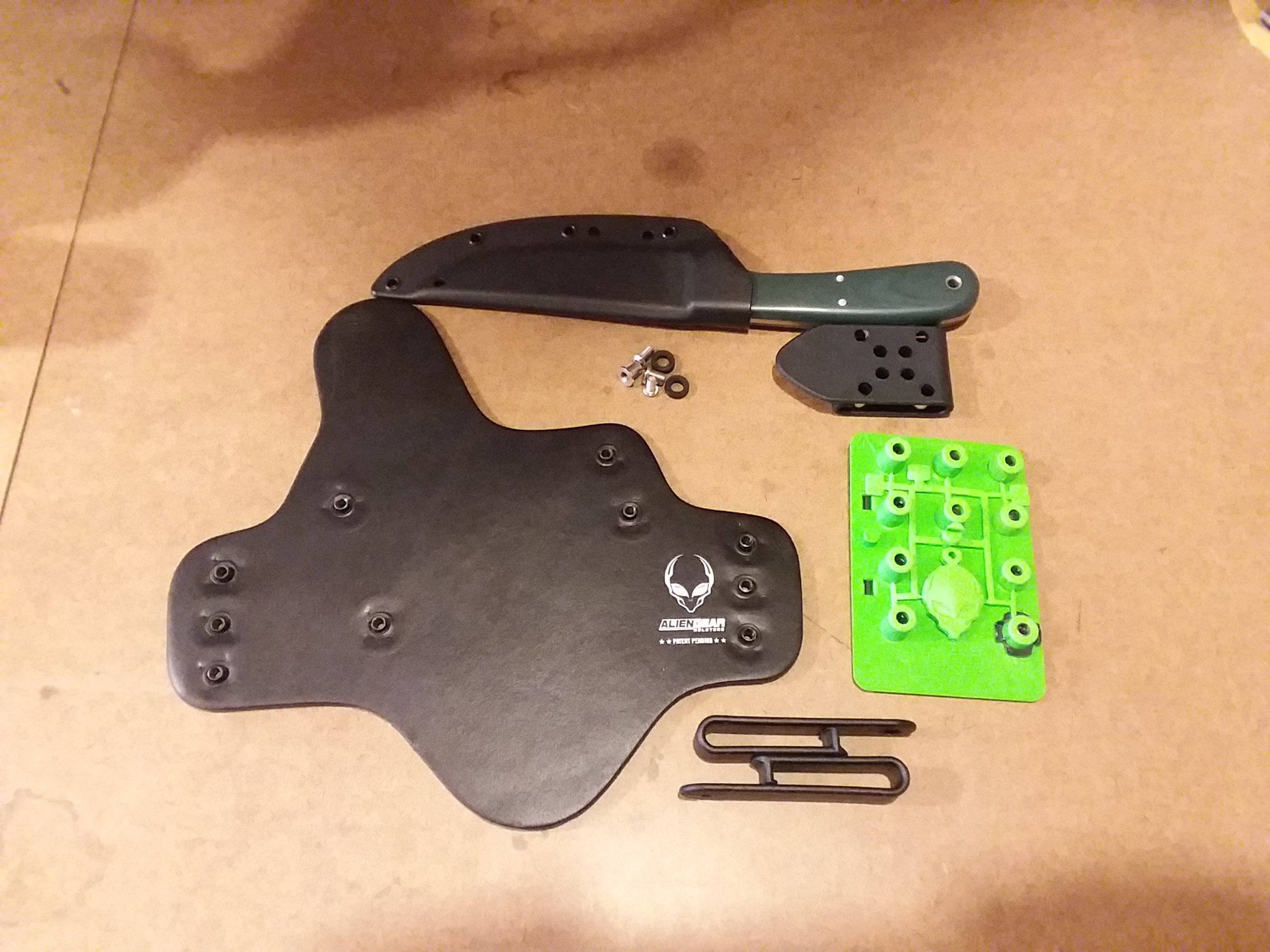 All the hardware needed to mount a kydex sheath on an Aliengear backer.