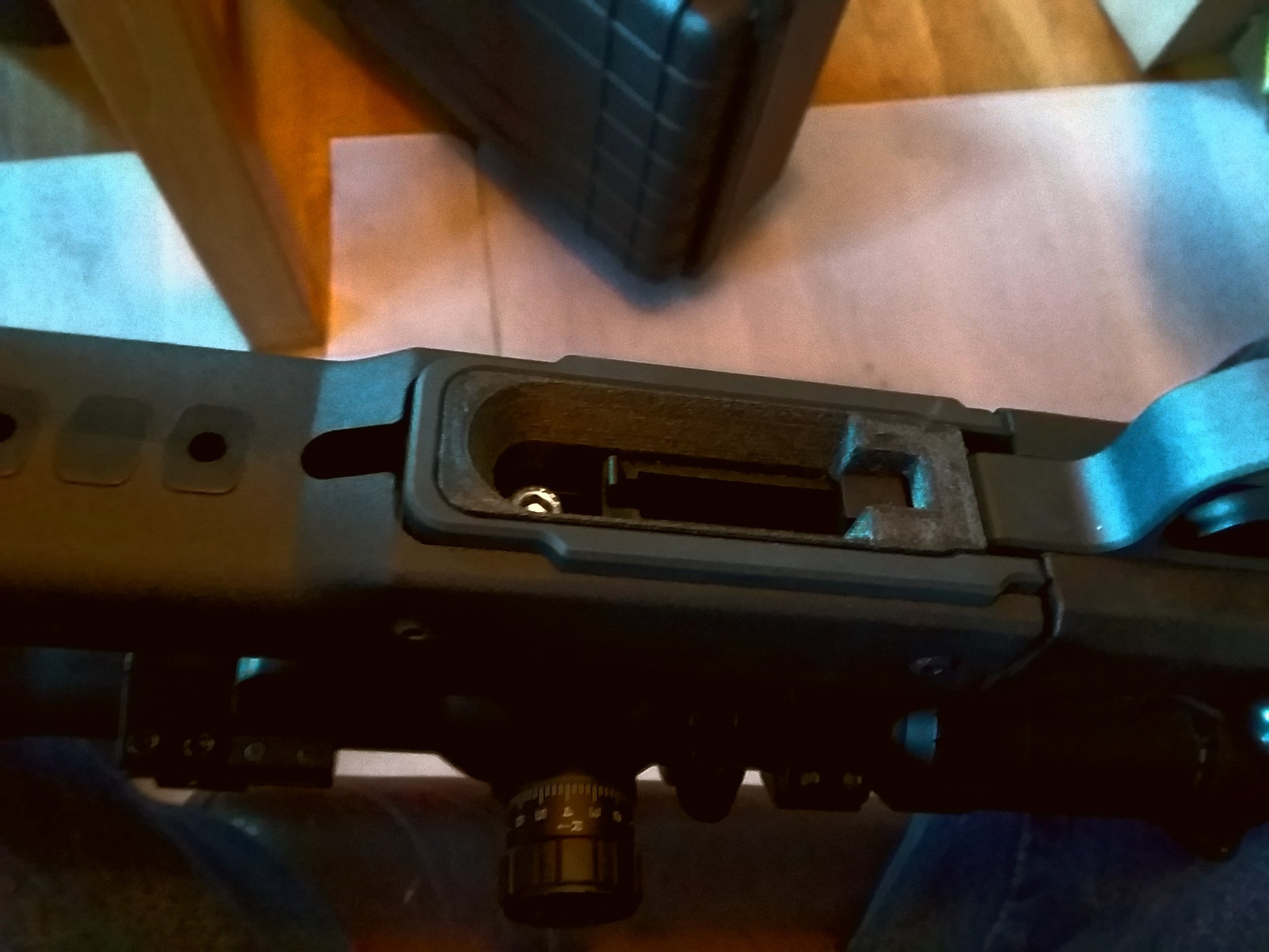 Magazine well installed. Much much better. Note the front action screw is still accessible, a deliberate design choice.