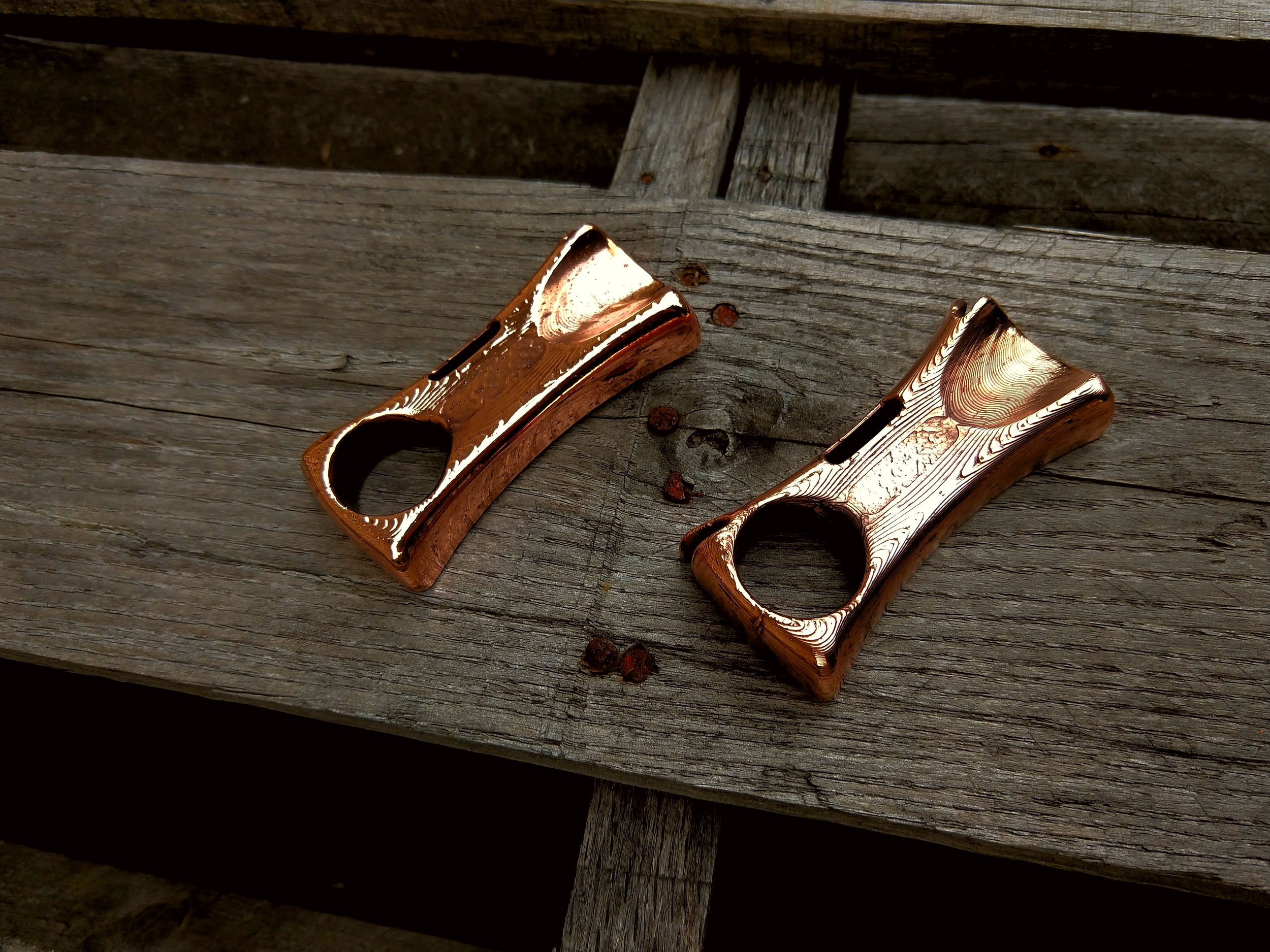 Two of our weaver slingshots in polished copper