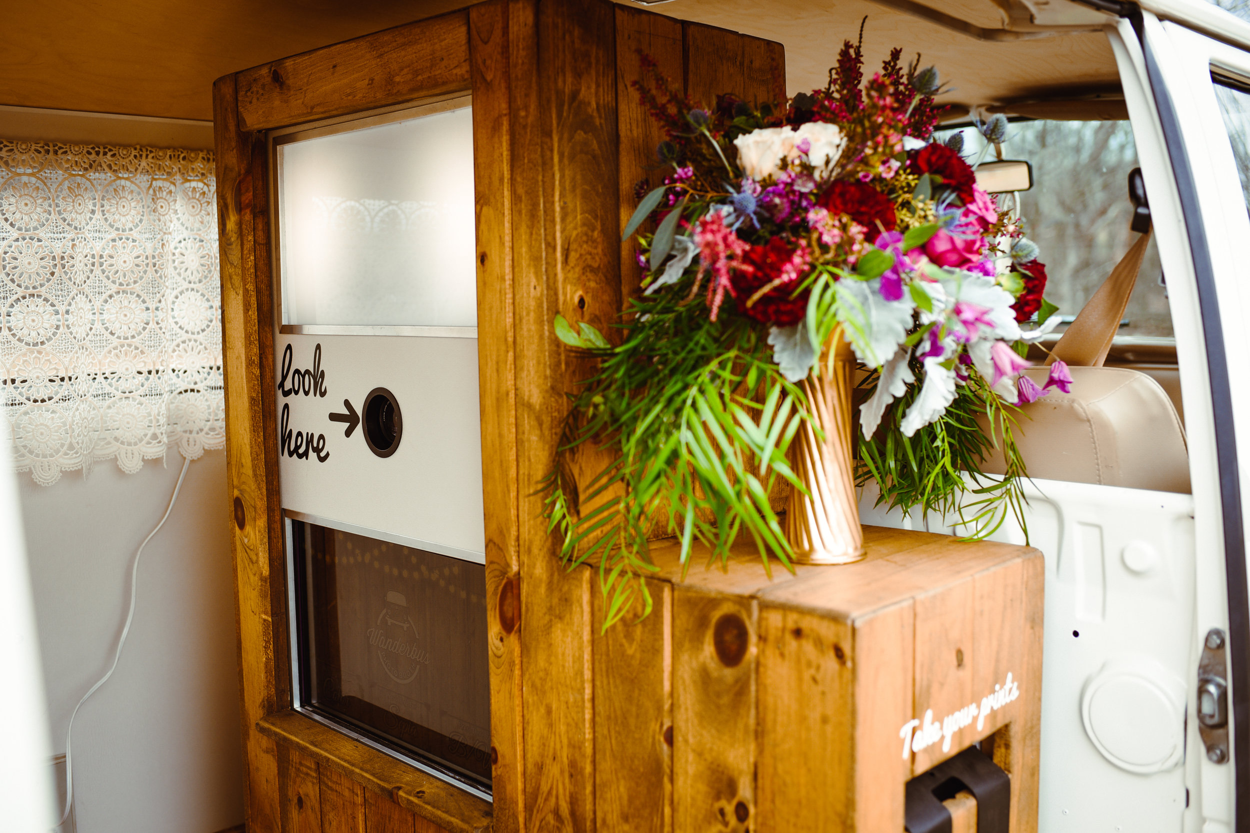Phoebe's Photo Booth - Phoebe's photo booth is nestled inside a custom built rustic wood cabinet.
