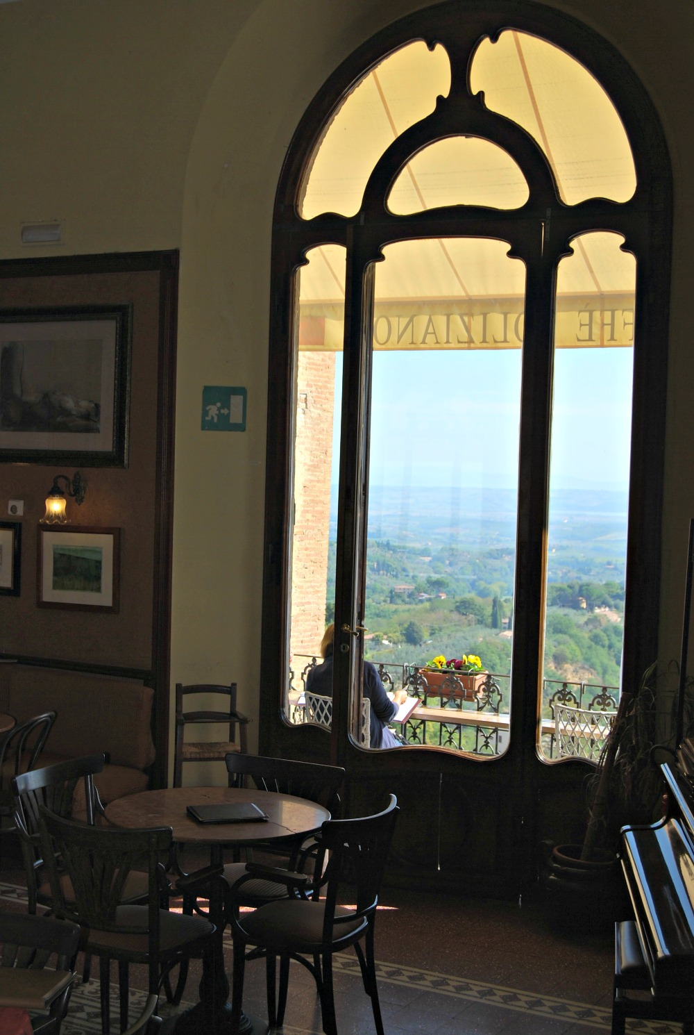- Caffe Poliziano dining room looking out to the balcony and countryside.