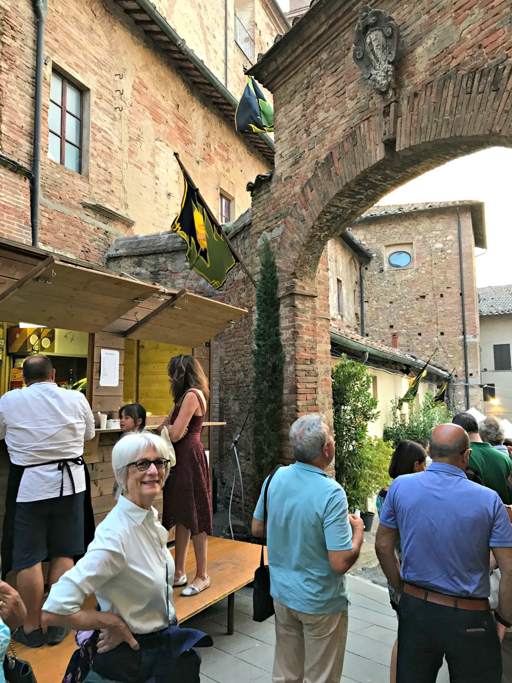 Waiting in line for yet another contrada dinner next to St. Augusto church.