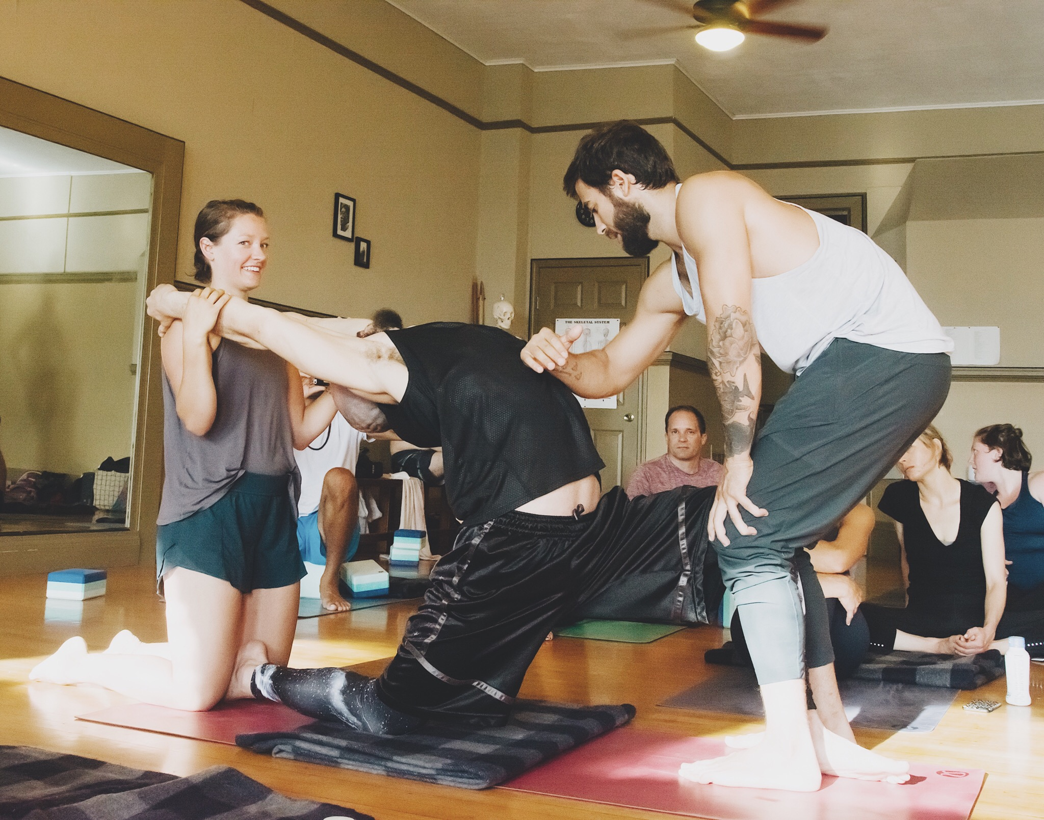 """""""Painting"""" our partners to help guide them deeper into their backbends."""