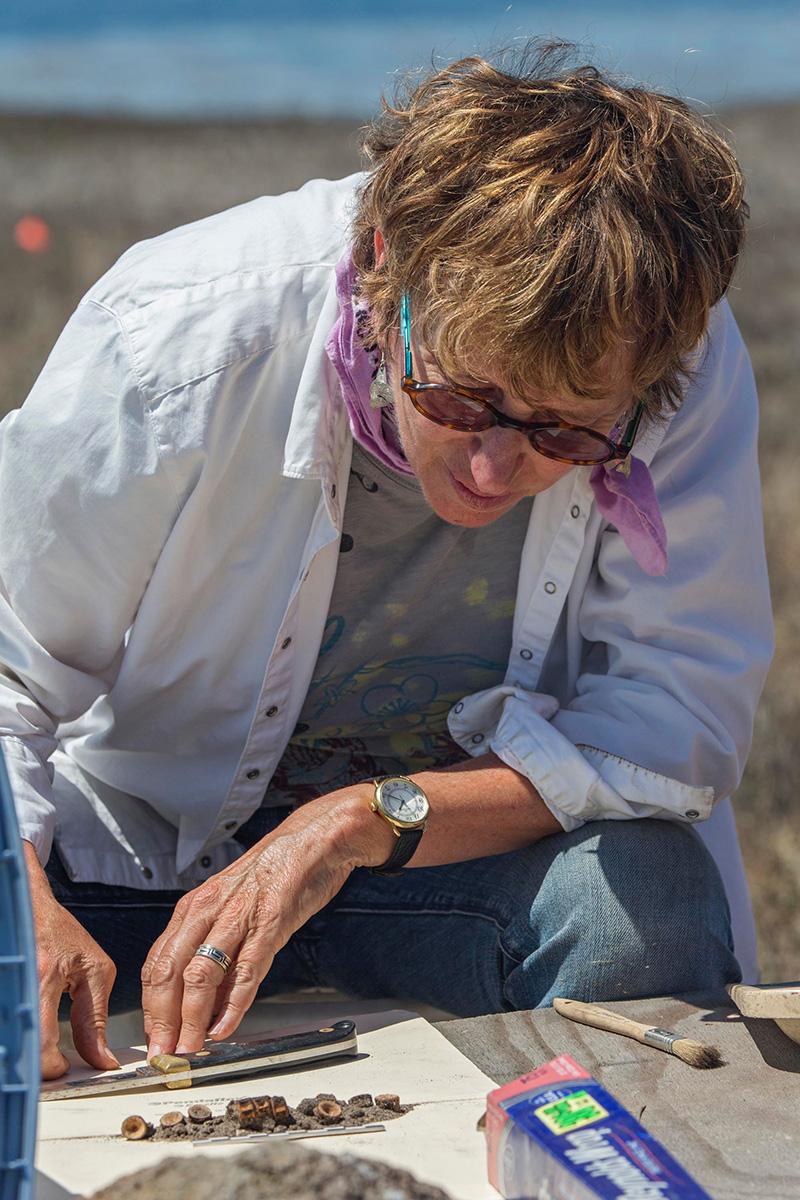 Lynn Gamble examining Chumash shell bead money