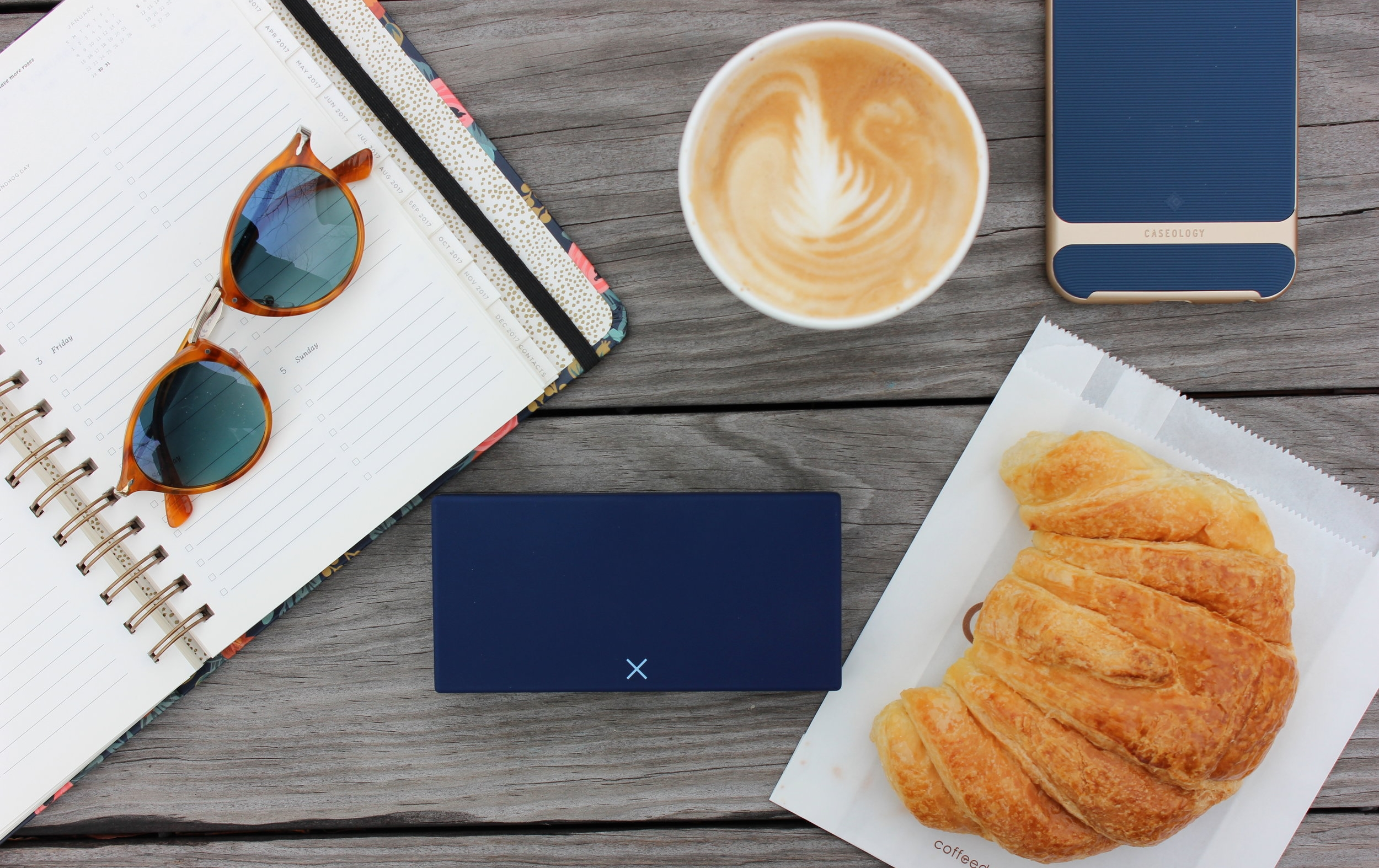 Blue pillbox with coffee and croissant
