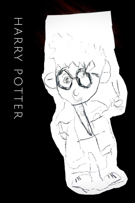 The little one channeled her inner wizard and drew Harry Potter.
