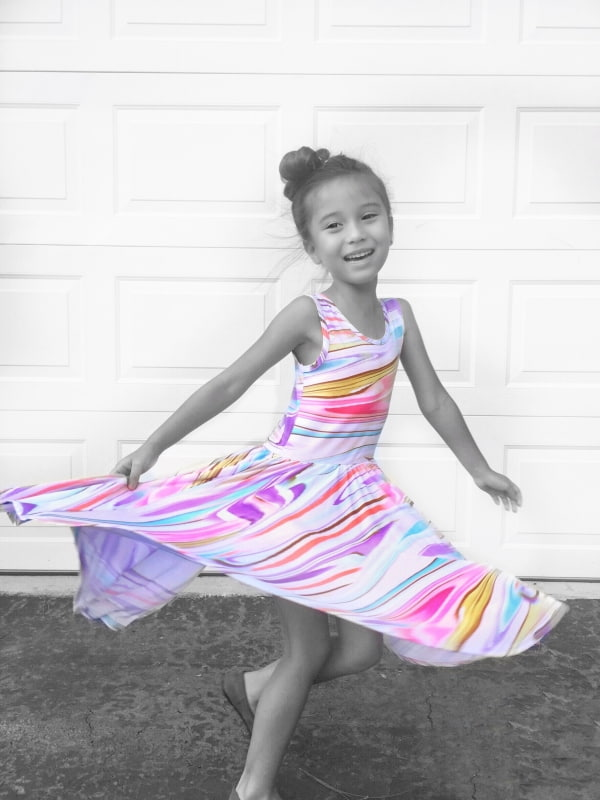 TWIRL ALL THE WAY TO NEVERLAND, LITTLE ONE!  This adorable  Twirly dress by Dotdotsmile Lori Weitzel VIP  in splashes of fun watercolors makes for the perfect summer dress.