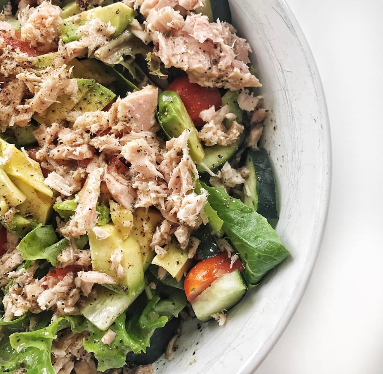 Greek Tuna Salad  Protein: Wild caught canned tuna Vegetables: Spring mix, cucumber, tomatoes, avocado Topping: Primal Kitchen greek salad dressing, salt, and pepper