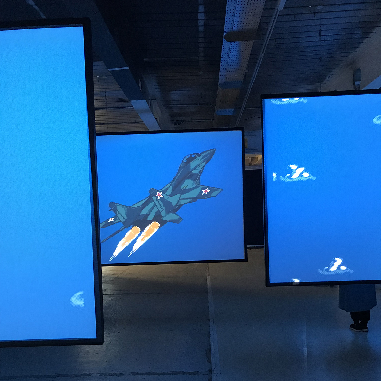 """Cory Arcangel's """"MIG 29 Soviet Fighter Plane and Clouds"""" (2005)"""