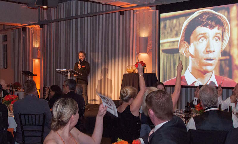 auGi speaking at Gala MS in Portland, OR. Photo courtesy of Fireworks Photography.