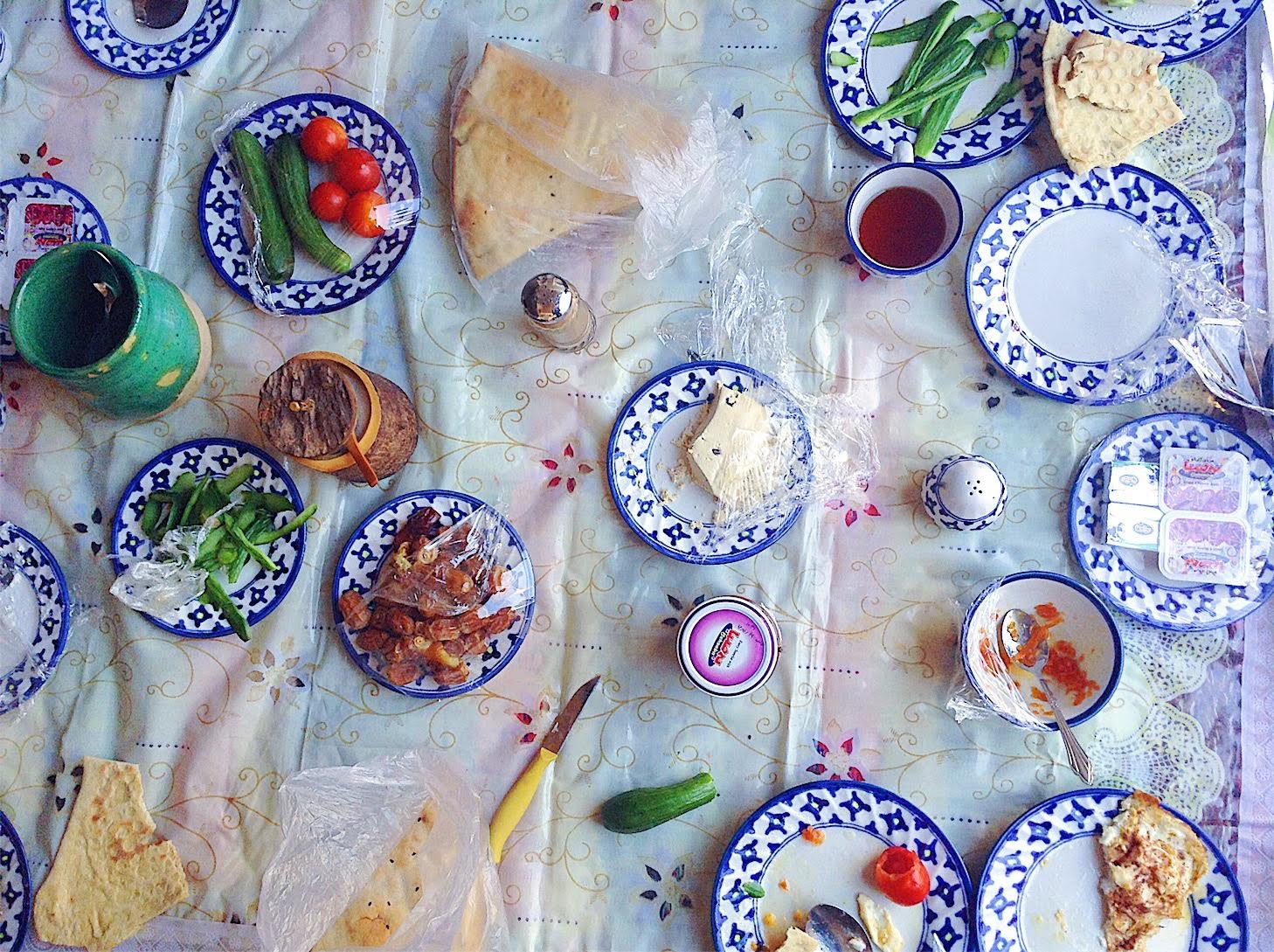 Delicious Persian breakfast at Barandaz Lodge in Mesr, Iran. Eggs with cinammon, dates, small cucumbers, feta cheese, homemade bread, halwa, carrot jam, sour cherry jam. Seriously, one of the best breakfasts I have eaten in my whole life!
