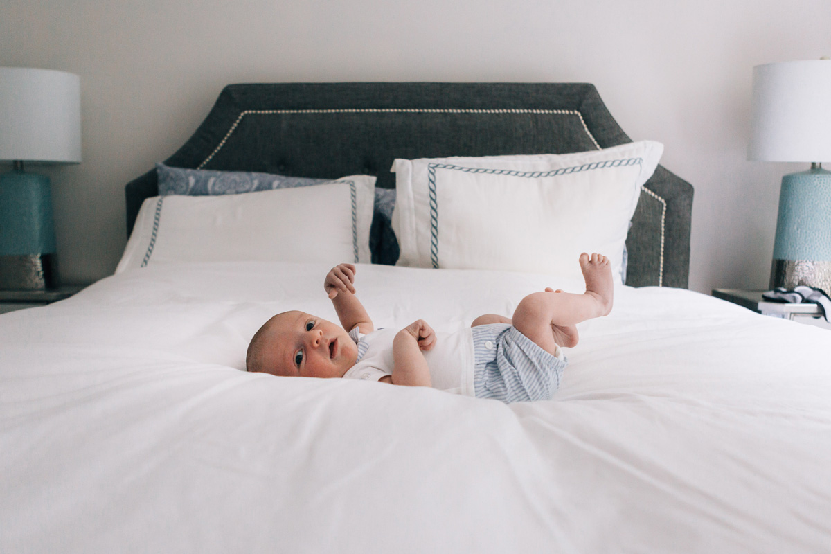 newborn baby on the bed - laura barr photography