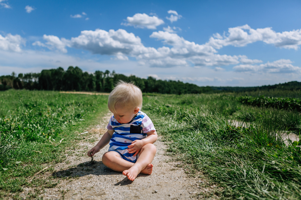baby on a dirt road