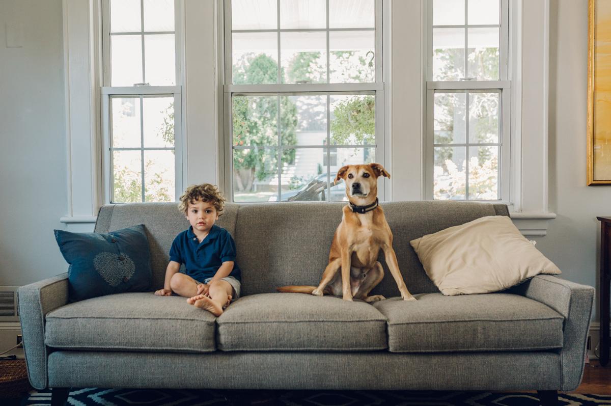 boy and his dog at home