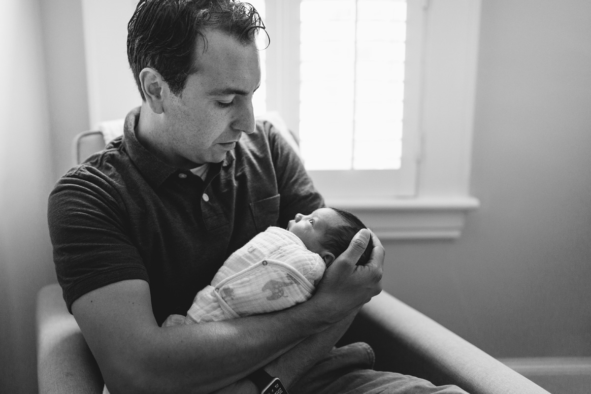dad holding daughter