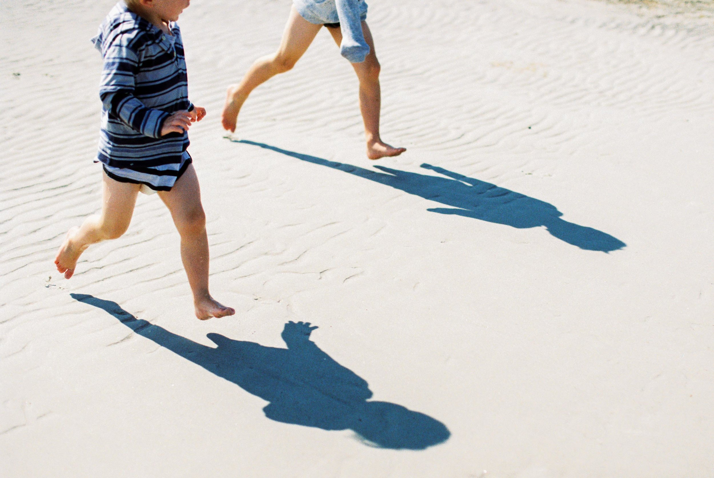barefoot on the beach on kodak film by laura barr photography