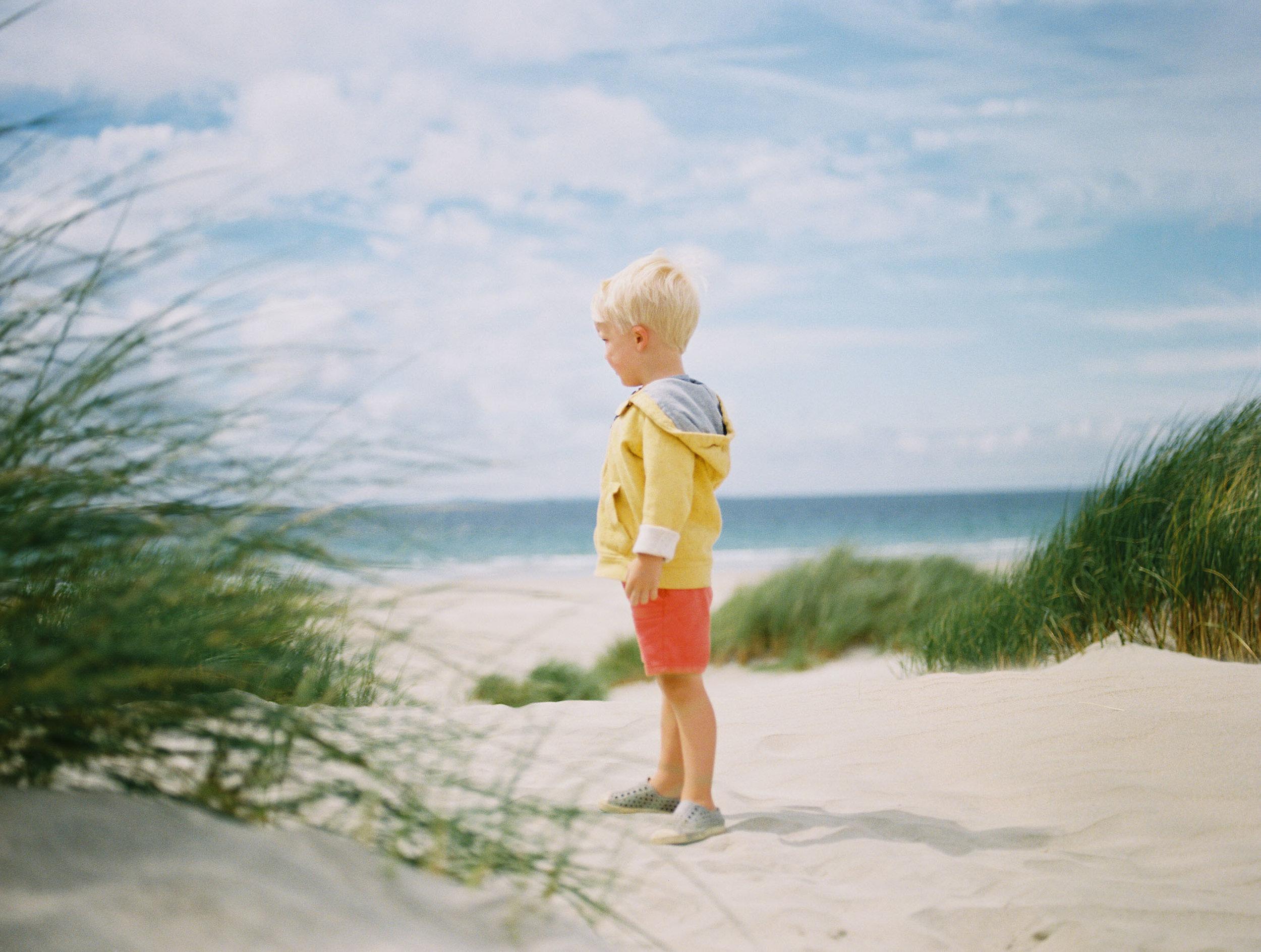 boy in the dunes on kodak portra 800 by laura barr