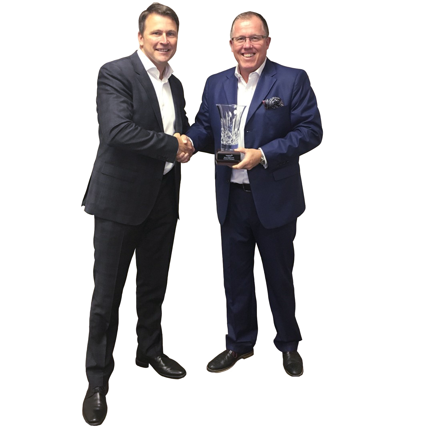 Andy Craig, Vice President of Sales (Right) Receiving Award from Eric Proulx for Best in Sales 2016 from Sealed Air