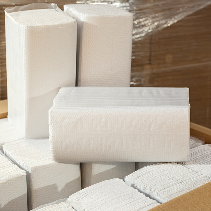 A box of paper towel stacks to be used in washroom dispensers.