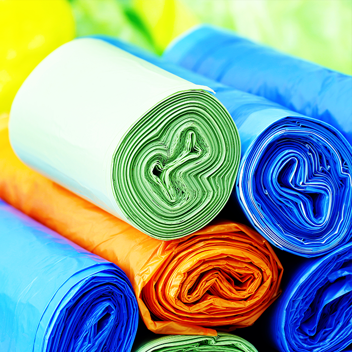A variety of garbage bag rolls in vary colours for sorting purposes.