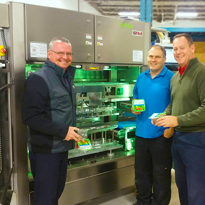 Doug Crowe, Sam Capson and Stuart Jackson with a Top Seal Packaging Machine from Packaging Automation running GrowPack Lidding Film.