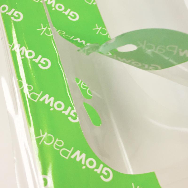 GrowPack Lidding film with tamper evident technology on green coloured lidding film
