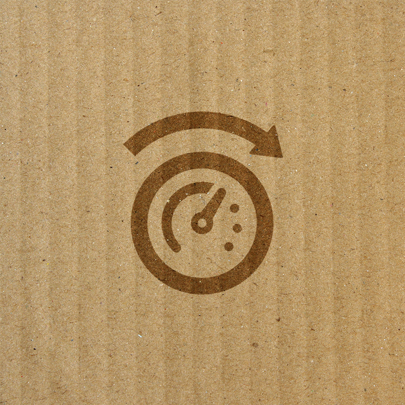 speedometer on top of cardboard texture background