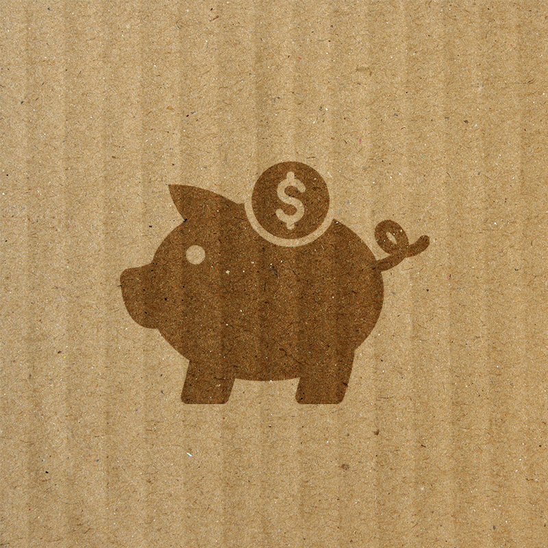 piggy bank on top of cardboard texture background
