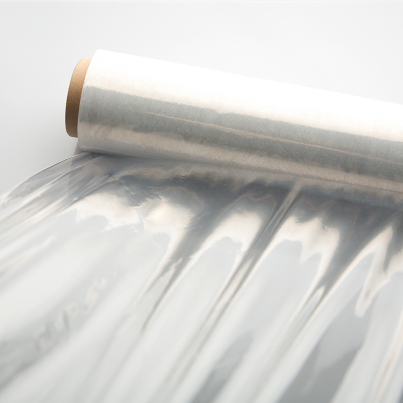 photo of a clear roll of shrink wrap film on a white background