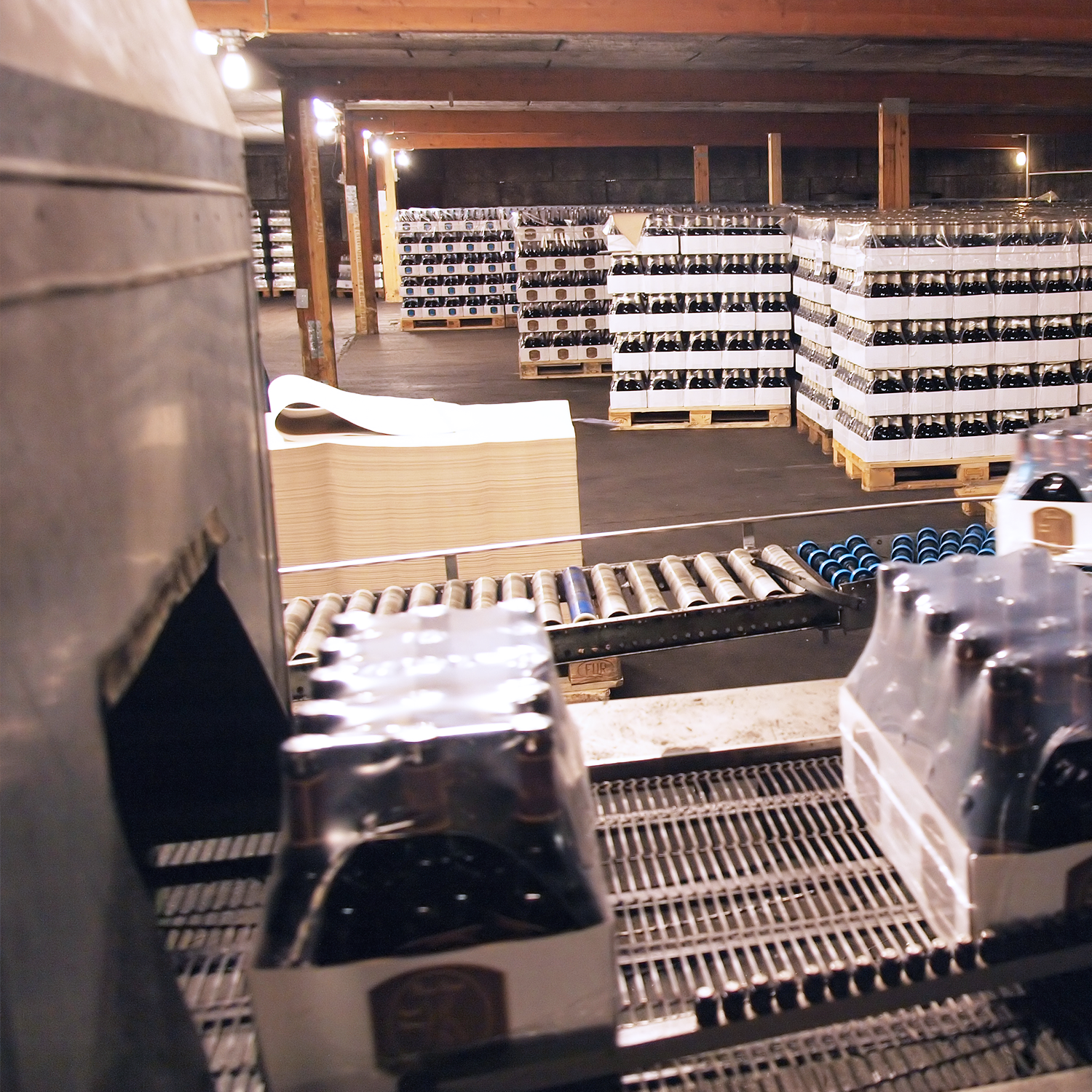 shrink wrapped cases of wine coming out of shrink tunnel in packaging facility