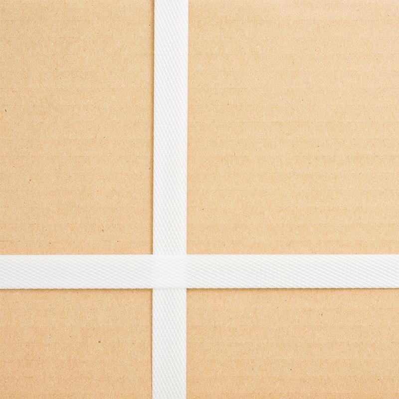 white polypropylene strapping securing brown cardboard box