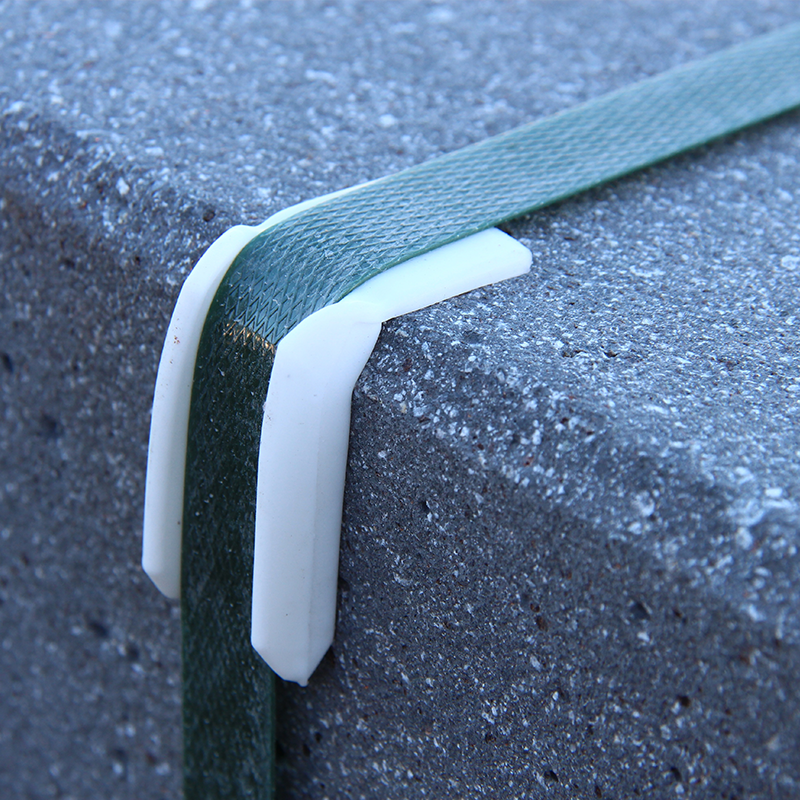 black polyester strapping securing heavy load of construction material