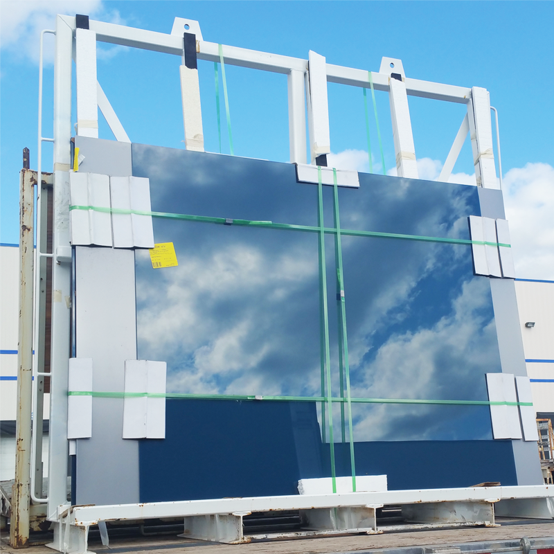 green steel strapping holding glass window pane in place attached to transport truck bed