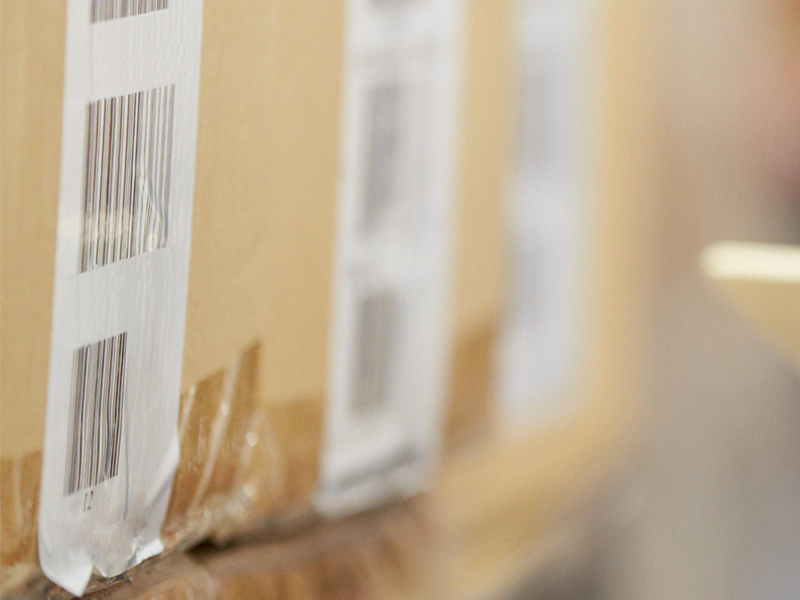 white barcode labels on cardboard boxes close up