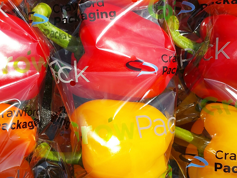 bell peppers wrapped in printed growpack flow wrap film on display