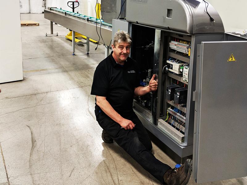 service technician making modifications to rgd mape vr8 flow wrap machine