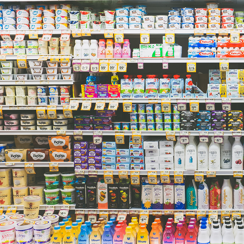rows of dairy products on retail shelft from multiple brands